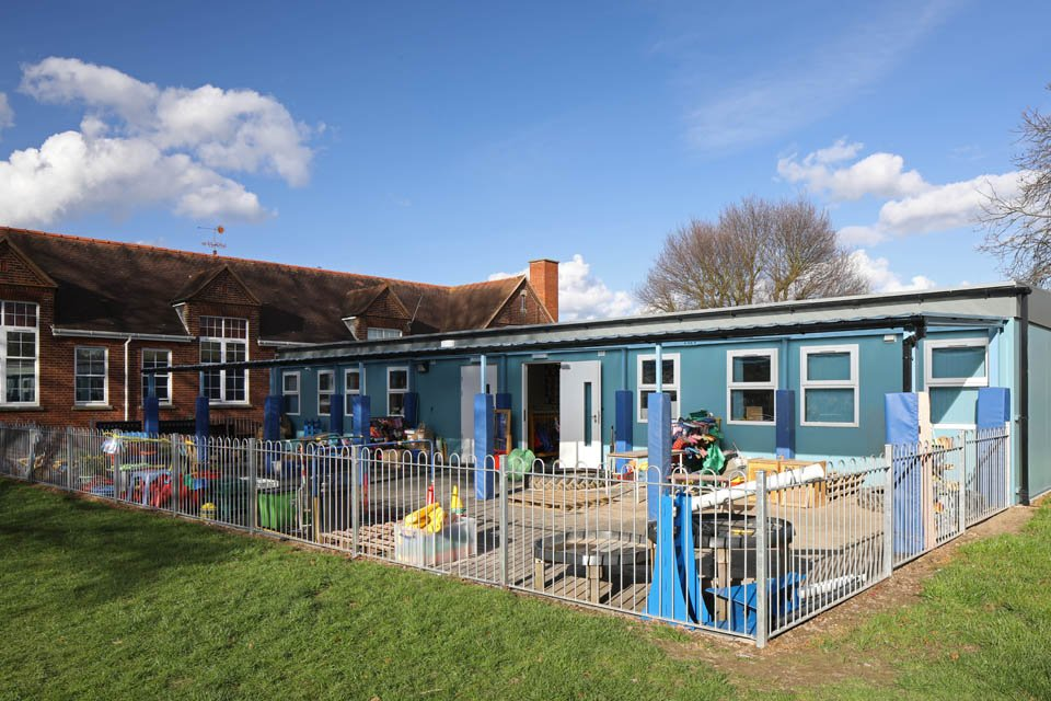A view of a modular classroom and outside play area at Stanway Primary School
