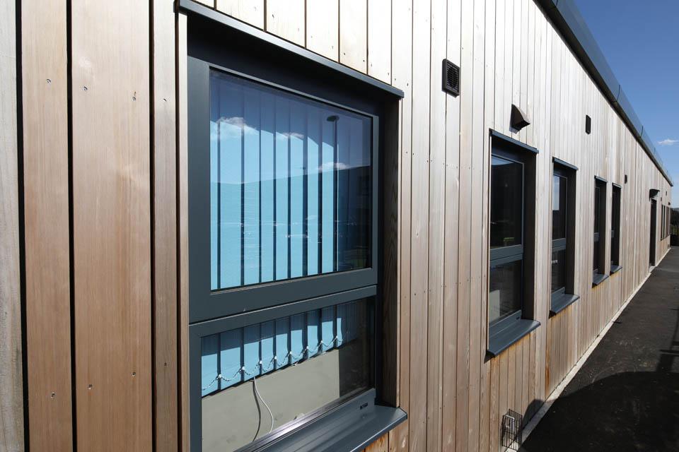 Close up of the windows of a modular classroom